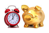 Alarm bell and golden piggy bank — Stock Photo