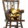 Stock Photo: Old wooden rocking chair and piggy bank captured with chain and padlock on