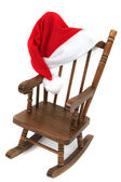 Old wooden rocking Chair with red jelly bag cap — Stock Photo