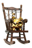 Old wooden rocking chair and piggy bank captured with chain and padlock on — Stock Photo