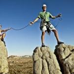 Team of climbers reaching the summit. — Stock Photo