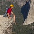 Rock climber celebrates on the summit. — Stock Photo
