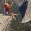 Royalty-Free Stock Photo: Rock climber celebrates on the summit.