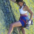 Female rock climber. - Foto de Stock