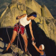 Female rock climbing team. - Stock Photo