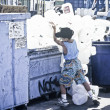 Young boy recycles plastic. — Stock Photo