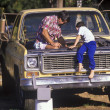 Father and son fixing truck. - Foto Stock
