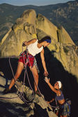 Female rock climbing team. — Stock Photo