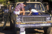Father and son fixing truck. — Stock Photo