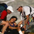 Stock Photo: Injured climber being rescued.