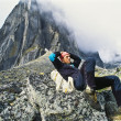Backpacker resting. - Stock Photo