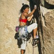 Стоковое фото: Rock climber clinging to a cliff.
