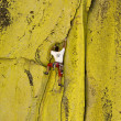 Male climber working his way up a steep crack. - Stok fotoraf