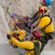 High angle rock climbing rescue. - Stock Photo