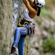 Photo: Female rock climber.