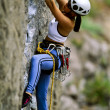Foto Stock: Female rock climber.