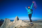 Female climber on the summit. — Stock Photo
