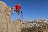 Rock climber celebrates on the summit. — Stock Photo