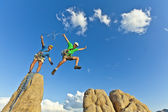 Rock climbing team reaching the summit. — Stock Photo