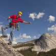 Stock Photo: Climber rappelling from the summit.