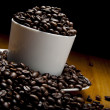 Cup of grains of coffee - Stock Photo