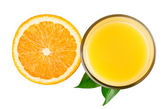 Half orange and juice with leaves from top — Stock Photo