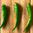 Green chilies on table — Stock Photo