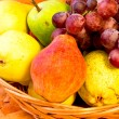 Yellow, red and green pears with bunch of red grapes - Stock Photo