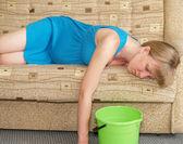 Toxicosis. The pregnant woman lies on a sofa — Stock Photo