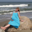 Stock Photo: Pregnant womrelaxing on shore of baltic sea