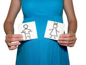 The pregnant woman holds drawings of the girl and the boy — Stock Photo