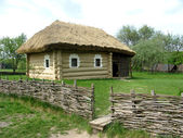 Country log hut in village of Ukraine — Stock Photo