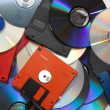 Stock Photo: Cds with diskettes