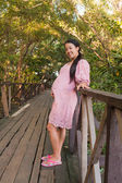 Asian pregnant women smiling in park — Stock Photo