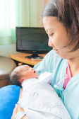 Asian female newborn in mother's arms vertical — Stock Photo