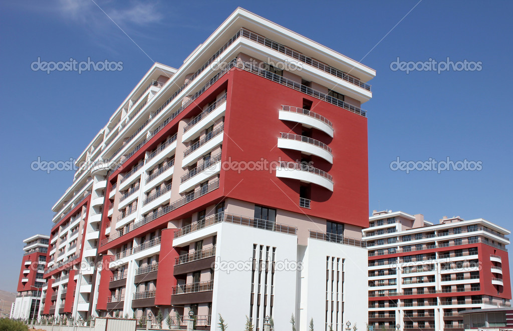 Apartment block over blue sky — Stock Photo #6856632