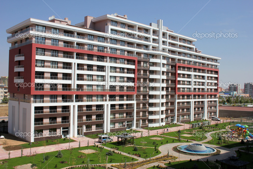 Apartment block over blue sky — Stockfoto #6857094