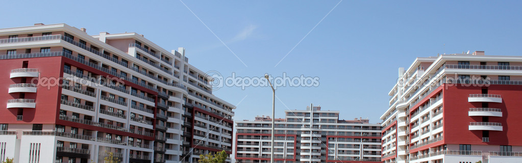 Apartment block over blue sky — Stock Photo #6857355