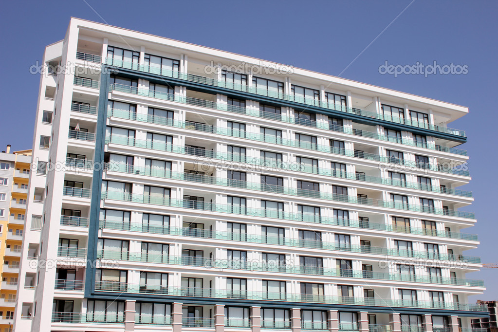 Apartment block over blue sky — Stock Photo #6858077