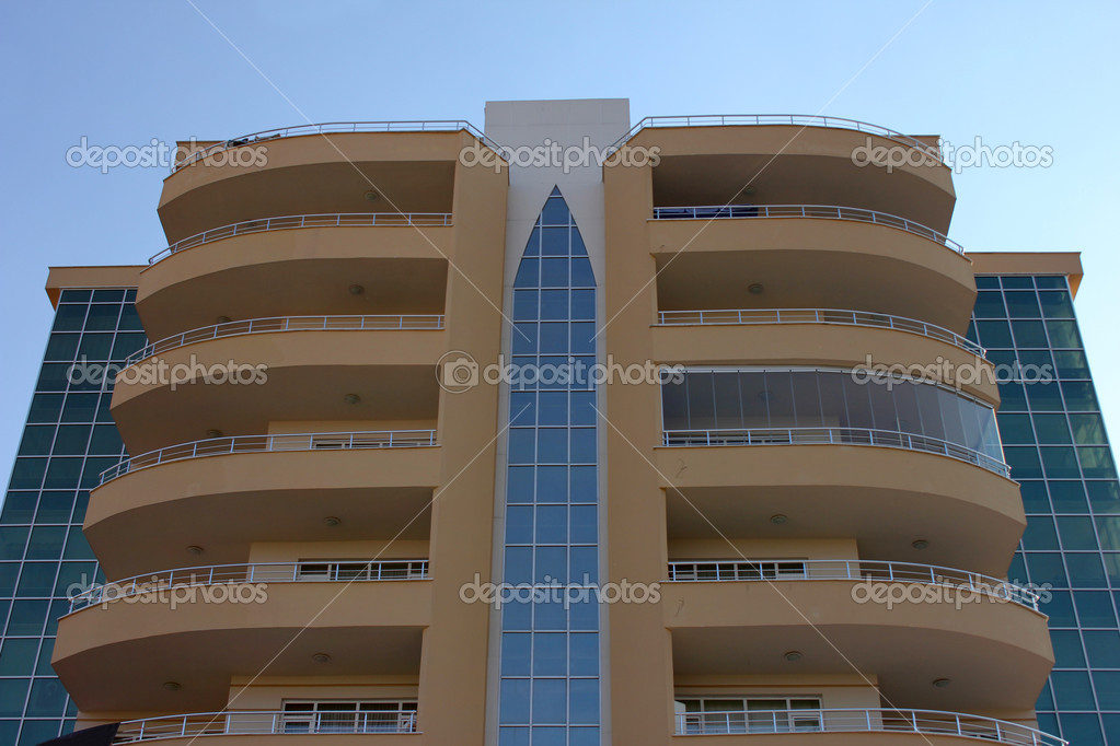Apartment block over blue sky — Lizenzfreies Foto #6860360