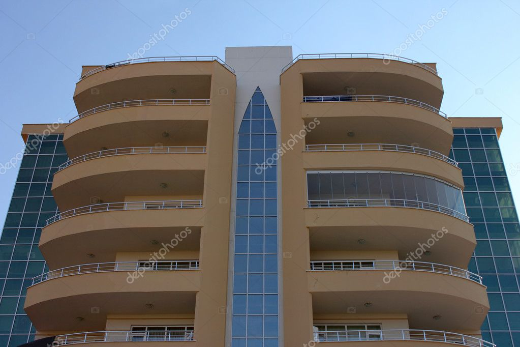 Apartment block over blue sky — Stok fotoğraf #6860360