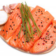 Fresh slices of salmon with color pepper, garlic, chives — Stock Photo
