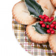 Plate of christmas mince pies with holly — Stockfoto #7498810