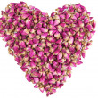Shape of heart made out of dried roses — Stock Photo #7736385