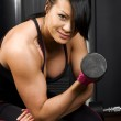 Asian woman working out with weights — Stock Photo