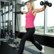 Stock Photo: Middle aged womworking out with weights