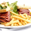 Stock Photo: Smoked meat sandwich with frys and ceasar