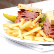 Smoked meat sandwich with frys and ceasar - Stock Photo