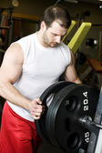 Man at bench press — Stock Photo