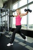 Middle aged woman working out with weights — Stock Photo